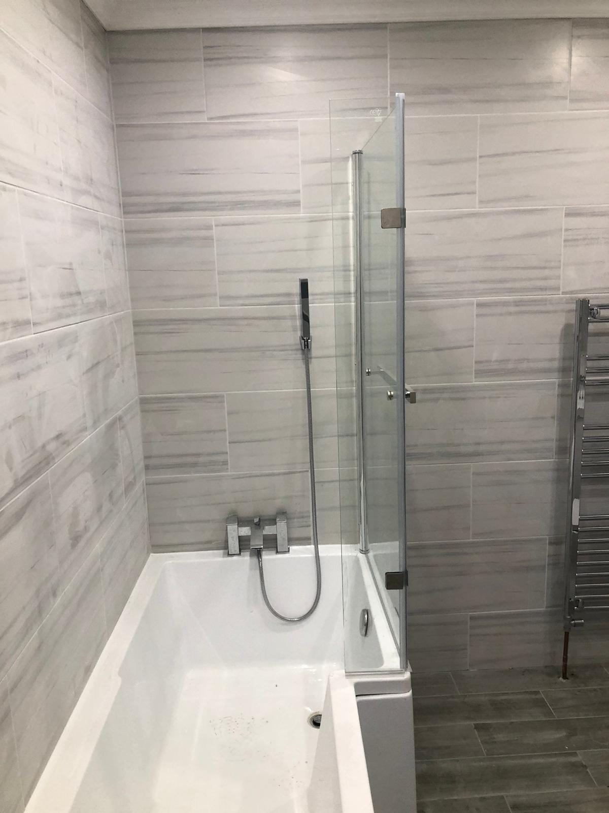 Bathtube with glass shild fitted by Birmingham Plumbing - Jack The Plumber
