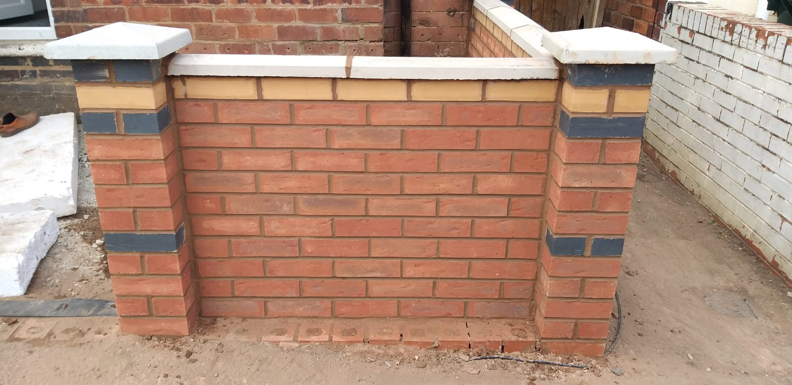 Driveway wall outside property made by Birmingham Plumbing - Jack-The-Plumber